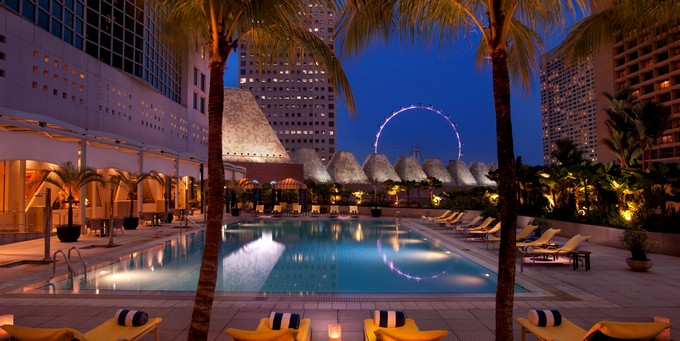 Outdoor Pool by Night with Singapore Flyer view